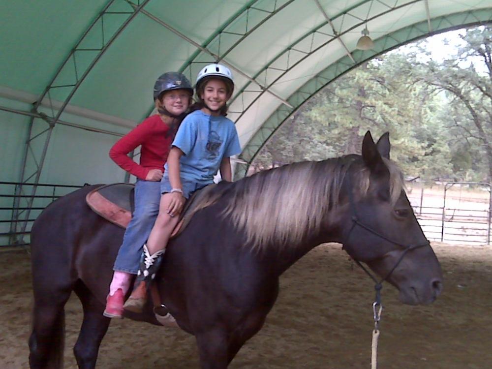 Matea and Kayla enjoy a summer vacation lesson