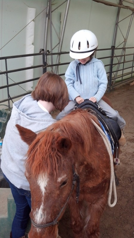 Lucia riding Tessa (with Maddy)
